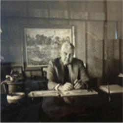 Image of Gerald Sheehan at his desk.