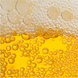 image closeup of beer and foam